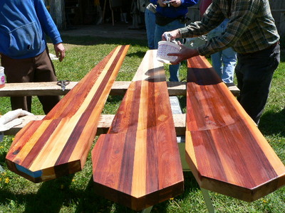 applying linseed oil to the blades